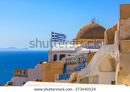 Greek flag waving on Santorini island in Greece - stock photo