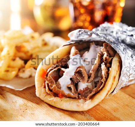 greek gyro with fries close up - stock photo
