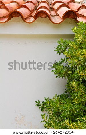 Greek house traditional authentic wall and tile roof  - stock photo