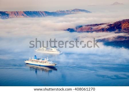 Greek islands in the morning fog, Santorini, Greece - stock photo