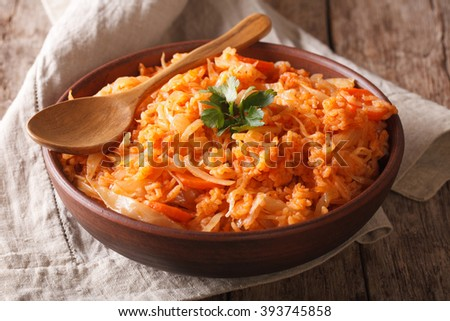 Greek lahanorizo rice with cabbage close up in a bowl on the table. horizontal