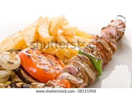 Greek Pork fillet souvlaki with potatoes and grilled vegatables - stock photo