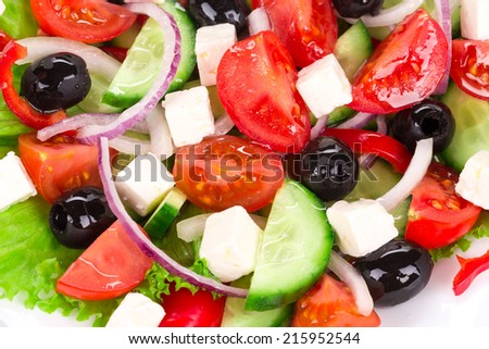 Greek salad as haute cuisine. Isolated on a white background.