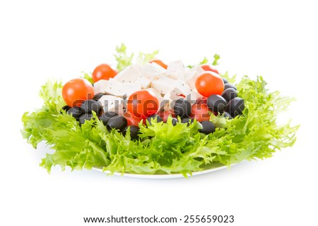 Greek salad in a plate on a white background, isolated
