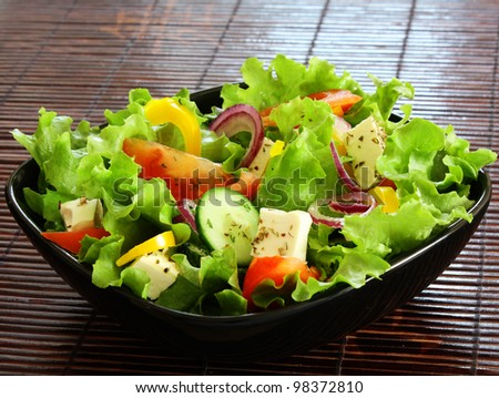 greek salad in black plate - stock photo
