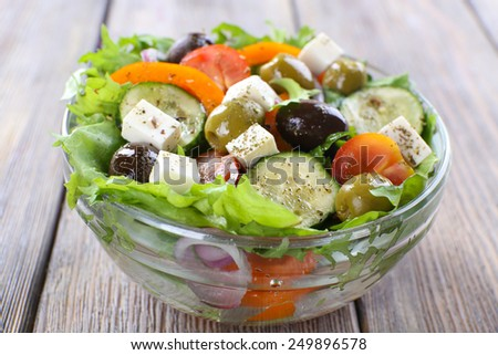 Greek salad in glass dish - stock photo