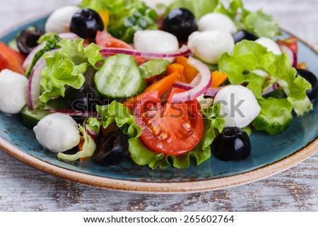 Greek salad , mini mozzarella in a bowl shape.selective focus - stock photo