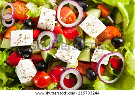 Greek Salad on Fresh Salad Leaf - stock photo