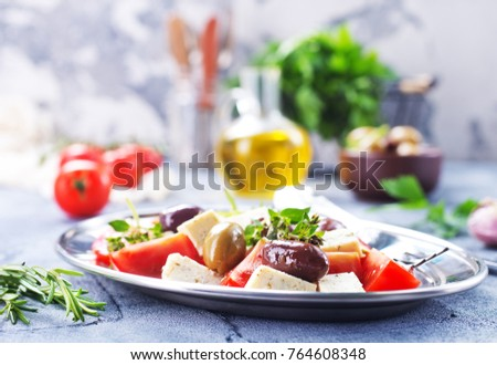 greek salad on plate and on a table