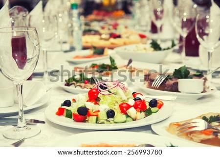 Greek salad on the festive table - stock photo