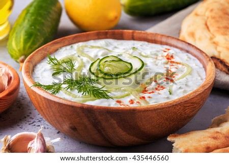 Greek salad tzatziki of cucumber, yogurt , olive oil, garlic, dill and spices, selective focus. - stock photo