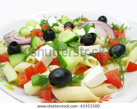 greek salad with cheese olive tomato and pasta