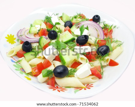 greek salad with cheese olive tomato and pasta - stock photo