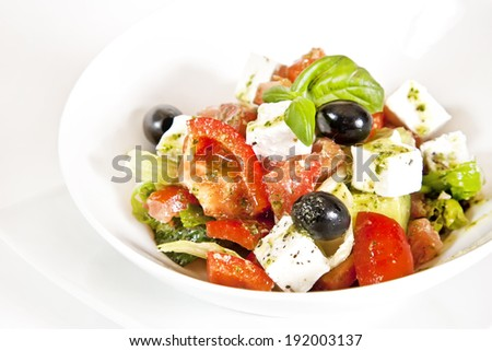 Greek salad with cucumbers, tomatoes, feta cheese, olives and sweet pepper