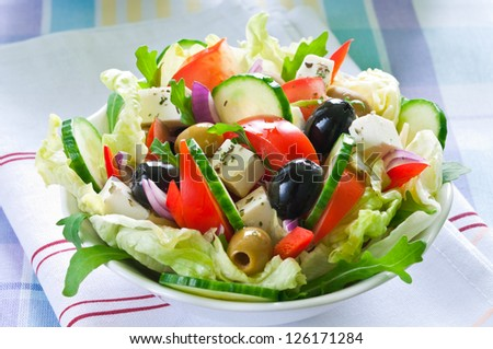 Greek salad with feta cheese and black and green olives - stock photo