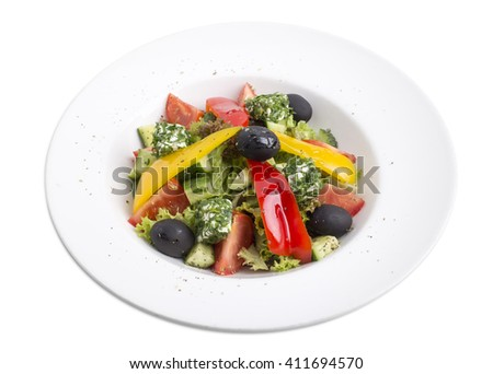 Greek salad with feta cheese and paprika. Isolated on a white background.