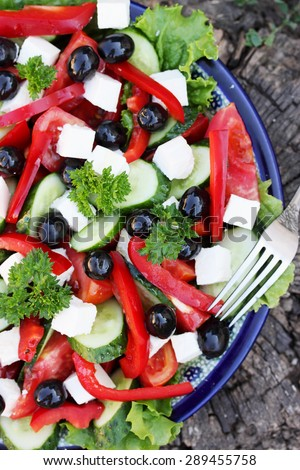 Greek salad with feta cheese,  olives and vegetables - stock photo