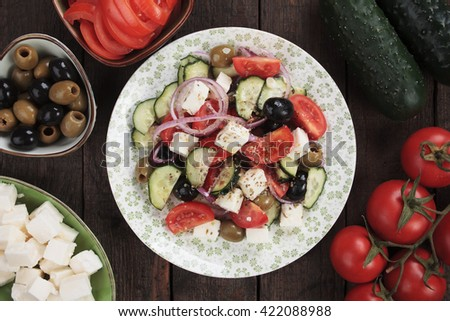 Greek salad with feta cheese, olives, cucumber, tomato and onion