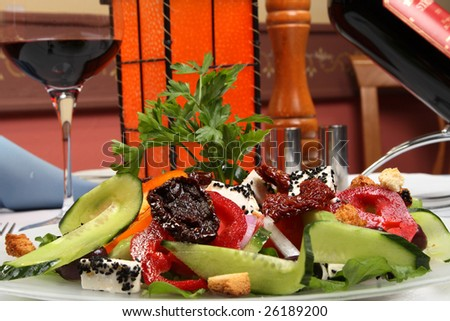 greek salad with tomato, cheese and olives - stock photo