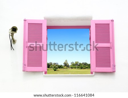 Greek style windows with cctv and country field view - stock photo