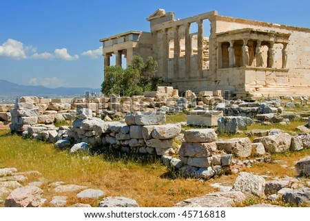 Greek temple (Parthenon) under reconstruction at the acropolis site in Athens, Greece - stock photo
