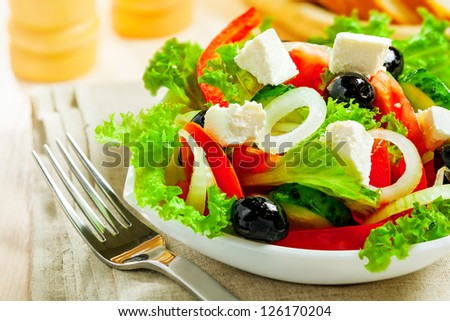 Greek vegetable salad with feta cheese - stock photo