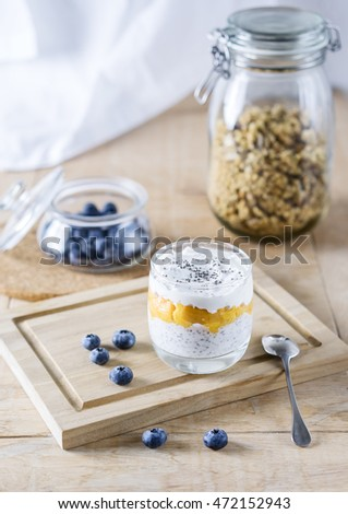 Greek yogurt with mango on the wooden table