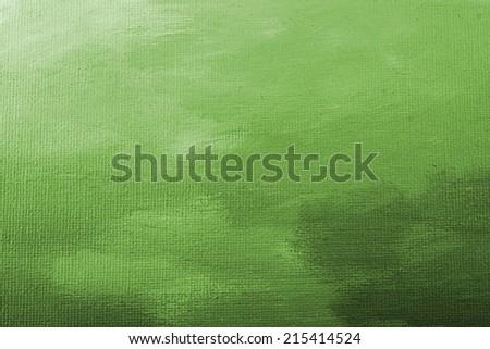 Green acrylic paint texture on white canvas. - stock photo