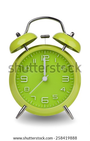 Green alarm clock with the hands at 12 am or pm isolated on a white background. One of a set of 12 images showing the top of the hour starting with 1 am / pm and going through all 12 hours - stock photo