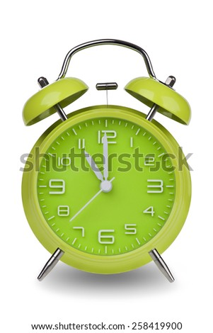 Green alarm clock with the hands at 11 am or pm isolated on a white background. One of a set of 12 images showing the top of the hour starting with 1 am / pm and going through all 12 hours - stock photo