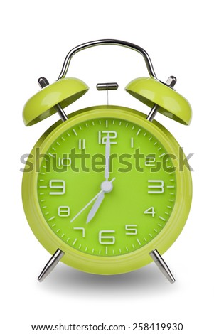 Green alarm clock with the hands at 7 am or pm isolated on a white background. One of a set of 12 images showing the top of the hour starting with 1 am / pm and going through all 12 hours - stock photo