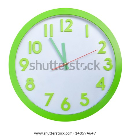 green alarm round wall clock five minute to twelve