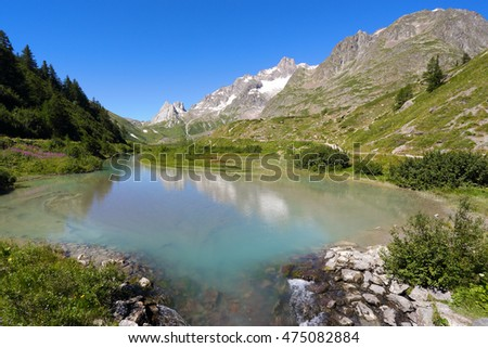 Green alpine lake and mountain landscape. Val Veny close to french border