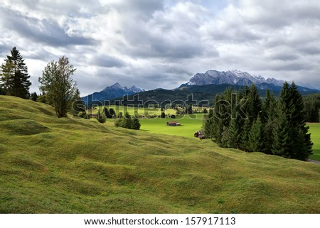 green alpine meadows and Karwendel mountains in Bavaria