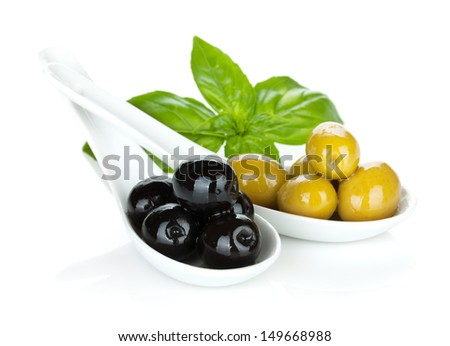 Green and black olives and basil - stock photo