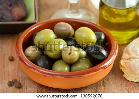 green and black olives in ceramic bowl