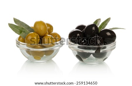 Green and black olives in glasses - stock photo