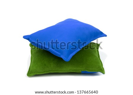 green and blue cushions over white background