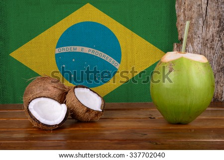Green and Brown Coconuts with Brazilian Flag - stock photo