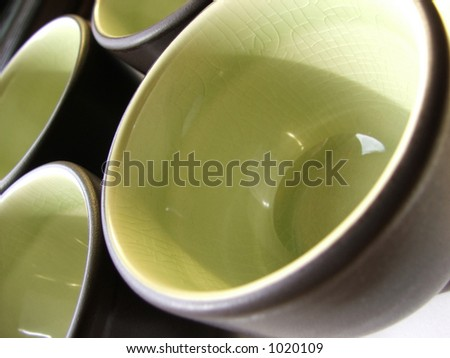 Green and dark brown teacups