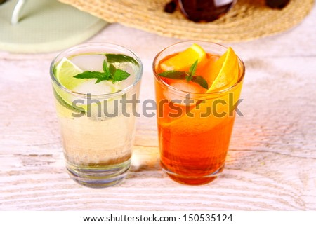 Green and orange cocktails with holiday background, close up
