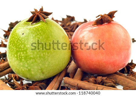Green and pink apple with spices close up - stock photo