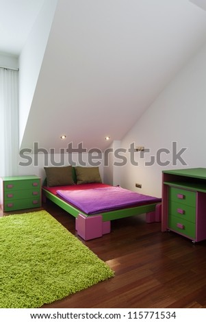 Green and pink children bedroom with a carpet - stock photo