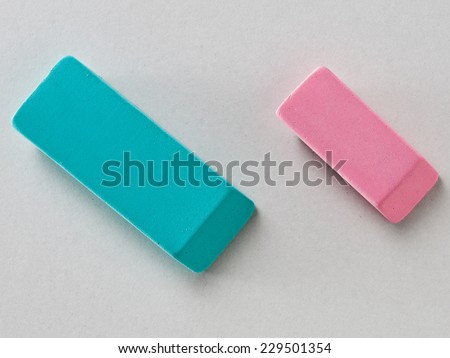 Green and Pink Erasers isolated on Grey Background with Real Shadow. Top View - stock photo