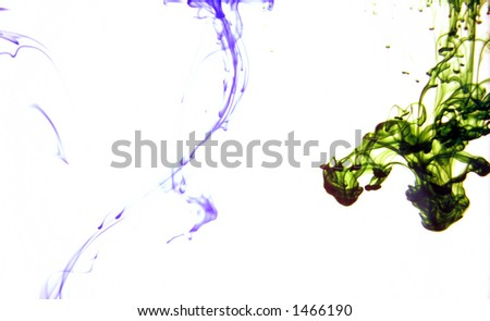 Green and purple dye in water - stock photo