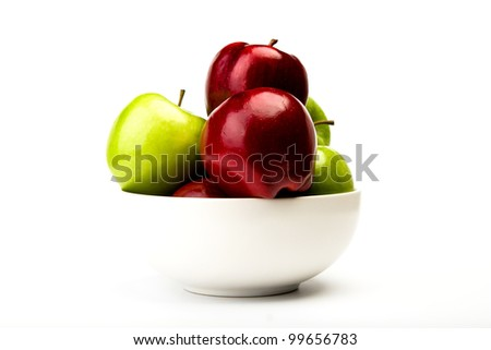 Green and red apple on plate isolated on white background