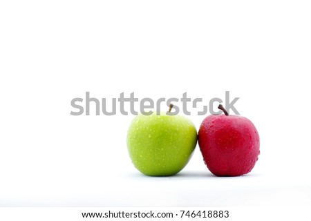 green and red apple side by side isolated in white background
