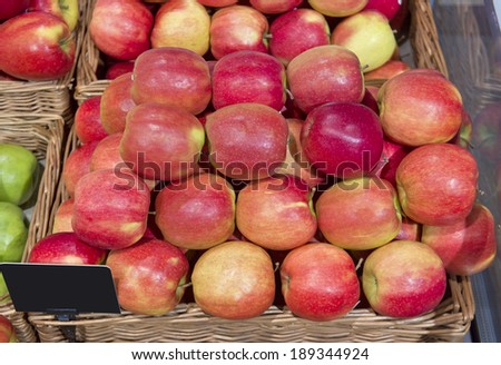Green and red apples in market