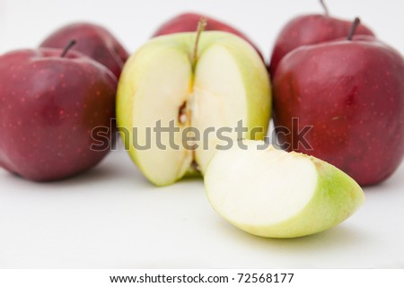Green and red apples on a white background