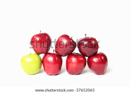 Green and red apples stacked. - stock photo